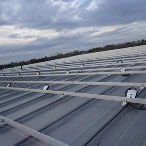 Sloped Standing Seam Metal Roof with Solar Racking