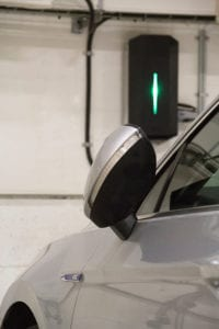 electric car charging in garage