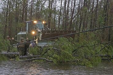 Marines removing a tree downed by Hurricane Florence in North Carolina