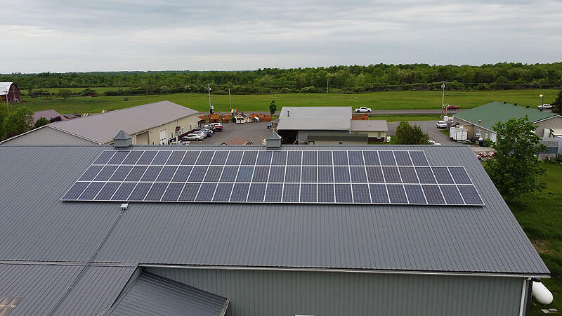 Pictures is solar panels installed on a metal ribbed roof