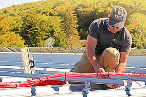 Installing wire runs at a commercial solar installation
