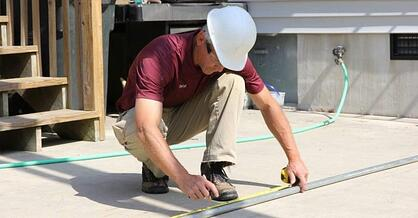 man measuring conduit