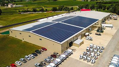 nuCamp RV manufacturing facility with solar panels