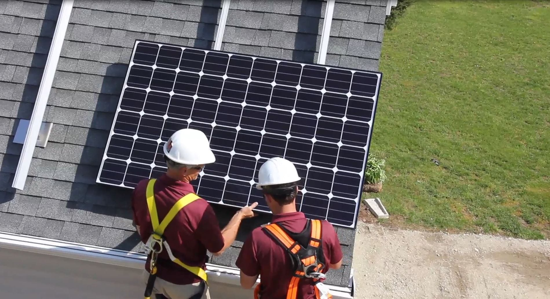 Paradise Energy Solar Installers Attaching Solar Panel